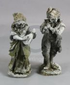 A pair of lead garden statues, modelled as a male horn player and female companion, H.1ft 10.5in.
