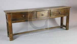 A late 18th century oak dresser base, fitted three long drawers, on stile feet with H stretcher W.