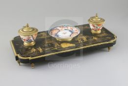 A French Louis XIV style ormolu mounted black lacquered ink stand, with Imari porcelain dish and