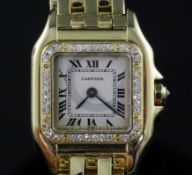 A lady's modern 18ct gold and diamond Cartier Panthere quartz wrist watch, with Roman dial and