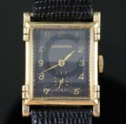 A gentlemans stylish 1930's 14k gold Longines manual wind wrist watch, with raised lugs and