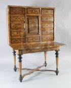 A Louis XIV inlaid walnut cabinet on stand, the upper section with twelve short drawers