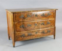 An 18th century German olivewood veneered commode with parquetry top and three long drawers fitted