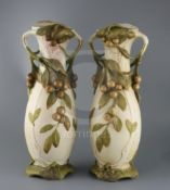 A pair of tall Royal Dux Art Nouveau two handled vases, early 20th century, each modelled with