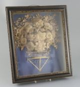 A George III cut-card relief picture, modelled as a basket of flowers, mounted within an ebonised
