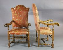 A pair of 19th century French 17th century style carved walnut high back armchairs, with floral