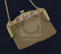 A French pierced 18ct gold, ruby, sapphire and diamond mesh evening purse, set with gem set floral