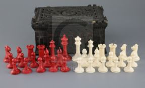 A Jaques & Son red stained and ivory Staunton pattern chess set, in Carton Pierre box, box