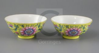 A pair of Chinese yellow ground famille rose bowls, Daoguang six character seal mark and probably of