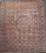 A Mahal red ground carpet, with field of geometric foliate motifs, 12ft 8in x 10ft 9in.