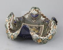 Frank A Butler for Doulton Lambeth, a rare quatrefoil fruit dish, c.1895, the centre moulded with