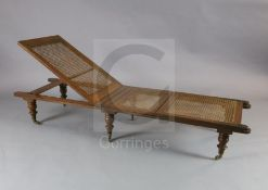 An early 19th century oak folding campaign day bed, the underside bearing a paper label - ''From