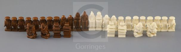 An unusual late 19th century Japanese brown stained and natural ivory figural chess set, modelled as