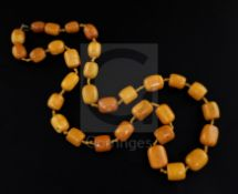 A single strand barrel shaped amber bead necklace, gross weight 131 grams, 86cm.