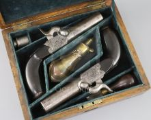 A pair of early 19th century box percussion lock pocket pistols, with scrolling engraved decoration,