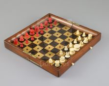 A Jaques & Son In Statu Quo mahogany and boxwood travelling chess set, with red stained and