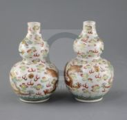 A pair of Chinese famille rose double gourd 'dragon' vases, Guangxu six character mark and of the