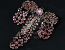A late 18th century French pinchbeck and shaped cut garnet set drop hair ornament, with black ribbon