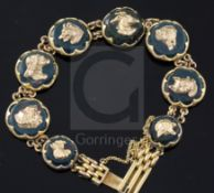 An early 20th century 9ct gold and bloodstone panel set bracelet, each stone mounted with a gold