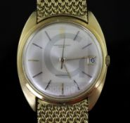 A gentleman's 1960's 18ct gold Audemars Piguet automatic wrist watch, with baton numerals and date