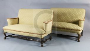 A Queen Anne upholstered scroll arm sofa and a matching reproduction sofa, with cabriole legs,