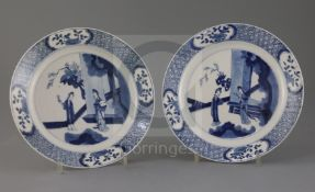 A pair of Chinese blue and white 'ladies' plates, Kangxi period, each painted with two ladies in a