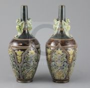 Frank A Butler for Doulton, a pair of Art Union of London bottle vases, c.1885, impressed marks