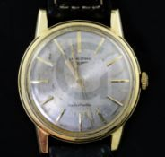 A gentleman's early 1960's 18ct gold Longines automatic wrist watch, with baton numerals, movement