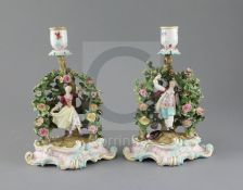 A pair of Meissen figural candlesticks, late 19th century, each modelled with a figure of either a