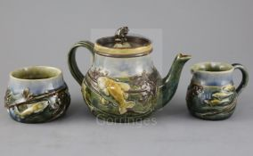 A Royal Doulton 'fish and pond weed' three-piece tea set, designed by George Tinworth, made c.