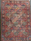 A Bakhtiari red ground carpet, with field of geometric flower heads and foliate border, 10ft 3 x