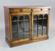 A William IV rosewood bookcase, with frieze drawer over two astragal glazed doors enclosing shelves,