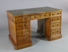 A Victorian walnut pedestal desk, with gilt green skiver and nine drawers fitted Bramah locks, W.4ft