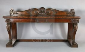 A Regency mahogany serving table, with scroll and scallop carved raised back and two frieze drawers,