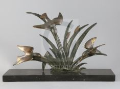 G. Limousin. A French Art Deco bronze group of three kingfishers flying amongst bulrushes, on