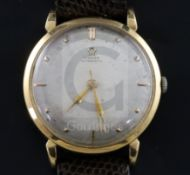 A gentleman's late 1940's 18ct gold Omega automatic wrist watch, the silvered dial with baton and