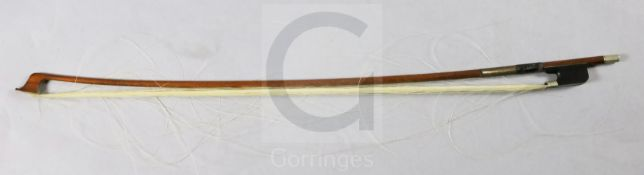 A nickel mounted cello bow, stamped 'Tubbs', the rounded stick appears to be of partridge wood, with