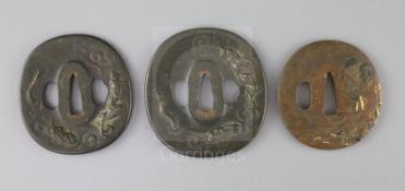 A set of Japanese daisho tsuba and a bronze and mixed metal tsuba, 19th century, the matching