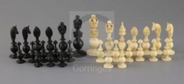 A mid 19th century Anglo Indian turned black stained and natural ivory chess set, kings 3.5in.