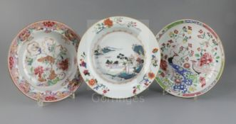 Three Chinese export famille rose dishes, Qianlong period, the first painted with a river landscape,