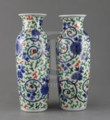 A pair of Chinese wucai vases, Qing dynasty, painted with lotus flowers, scrolling tendrils and