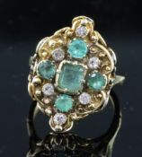 A Victorian gold, five stone emerald and six stone diamond set cluster dress ring, of lozenge form