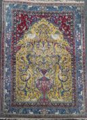 An antique North West Persian Tree of Life yellow ground carpet, with field of animals and birds