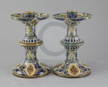 Edith D Lupton for Doulton, a pair of monogrammed candlesticks, dated 1879, each incised with
