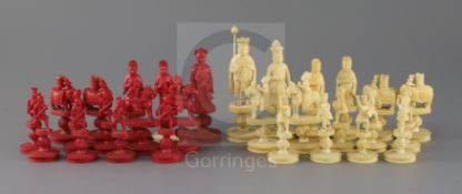 An early 19th century Chinese red stained and natural ivory 'rosette' type chess set, modelled as