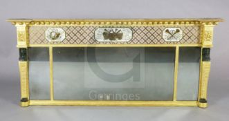 A Regency giltwood overmantel mirror, with ball frieze over an eglomise panel of musical trophies