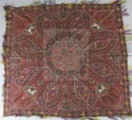 A 19th century Kashmiri handwoven silk shawl, woven with a design of figures, some on horseback,