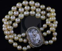 A triple strand cultured bracelet, now with a Regency gold mounted oval panel mourning clasp,