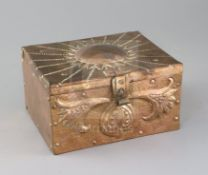 John Pearson. An Arts & Crafts Newlyn copper casket, with sunflower decorated lid and stylised