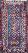 A Kazak Caucasian runner, woven with a central row of six large lozenges, within a multiple